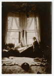 Josephine Peary reading by window