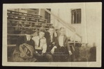 Four Westbrook Seminary Students Sitting on Bleachers, 1919-1920