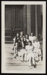 Seven Westbrook Junior College Students Sit on Alumni Hall Steps, Mid 1940s