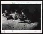 Two Students Studying on Bed, Westbrook Junior College, 1950s by Ellis Herwig