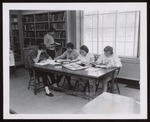 Five Students in Proctor Hall Library, Westbrook Junior College, 1957