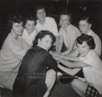 Seven Students Clasping Hands in a Cheer, Westbrook Junior College, 1957