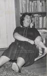 Student Leaning against Bookshelf, Westbrook Junior College, 1957