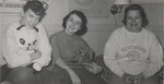 Three Students Sitting on a Bed, Westbrook Junior College, 1957