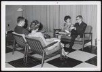 Two Students with Dates in Wing Lounge, Alexander Hall, Westbrook Junior College, ca.1964