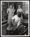 Student Arranging Shakespearean Festival Costume Exhibit in Library, Proctor Hall, Westbrook Junior College, 1965