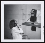 Student Using Pay Phone, Linnell Hall, Westbrook Junior College, 1966