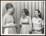 "Three Students ""Awarding"" an Envelope, Westbook Junior College, 1969"