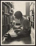 Student Sitting on the Library Floor, Westbrook Junior College, Mid 1960s
