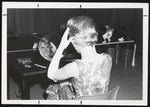 Westbrook Junior College Student Trying on a Wig, 1967