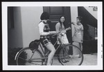 Three Students and Bicycle in Front of Proctor Hall, Westbrook Junior College, 1969
