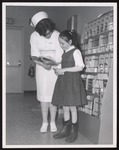 Dental Hygiene Student Helps Girl, Westbrook Junior College, 1960s