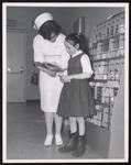 Dental Hygiene Student Helps Girl, Westbrook Junior College, 1960s