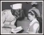 Dental Hygiene Student Assists Girl, Westbrook Junior College, 1960s