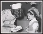 Dental Hygiene Student Assists Girl, Westbrook Junior College, 1960s