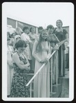 Four Westbrook College Students in Long Dresses Stand at Railing, 1970s
