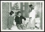 Three Students Overlook Proctor Breezeway, Westbrook College, 1970s
