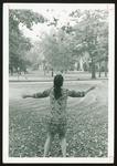 Westbrook College Student in Batik Dress Tossing Leaves, 1970s
