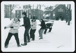 Five Students Play Tug-A-War in the Snow, Westbrook College, 1970s