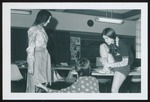 Three Fashion Merchandising Students Hem a Skirt, Westbrook College, 1970s