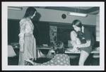 Three Fashion Merchandising Students Hem a Skirt, Westbrook College, 1970s