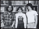 Three Students at Library Bookshelves, Westbrook College, 1970s