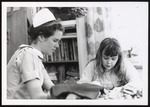 Nursing Student with Little Girl, Westbrook College, 1970s