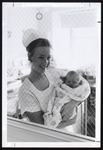Nursing Student Holds a Newborn Up to the Viewing Window, Westbrook College, 1970s
