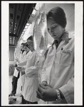 Four Nursing Students at Intravenous Solution Bags, Westbrook College, 1970s by Ellis Herwig Photography